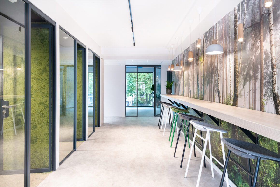 BECI Brussels workspace design and renovation by Space Refinery - hallway high wall table and forest wallpaper